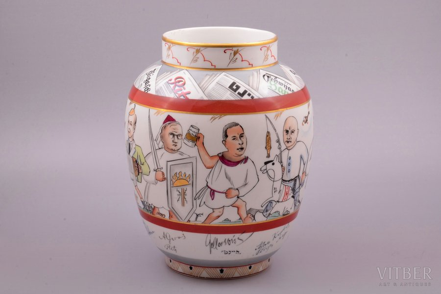 "vase, ""Press Media Festivity"", the cartoons of the chief editors of periodicals of the epoch, with original autographs around the vase's circle, on the upper part of the vase are the titles of periodicals, the corresponding cartoons and editor's autographs, porcelain, M.S. Kuznetsov manufactory, signed painter's work, handpainted by Vladimir Kandiyev, sketch by Romans Suta, Latvia, 1935, h 24.5 cm, Ø 19.5 cm, in the 1930s, the Press Media Festivity was organized annually in Latvia. The event was a very significant, elite event. At the factory of M.S. Kuznetsov, under the direction and with the participation of leading artists and sculptors, from one to several unique works dedicated to this event were created. The presented lot was made for the Press Media Festivity of 1935 in a single copy, as evidenced by the signature of the technical director of the factory Alexey Turkov (AT) with the label ""1"" (meaning of the mark: single copy work in the submitted shape and painted by the sketch)."