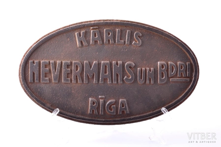 "cast iron plaque, company ""Kārlis Nevermans un biedri"", Riga, plaque was embedded in asphalt in Mežaparks, Latvia, the 20-30ties of 20th cent., 30.5 x 17.8 x 1.9 cm, weight 4700 g"