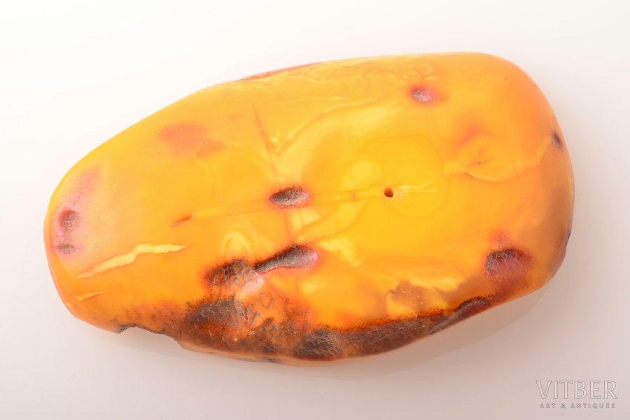 amber, 118.10 g., dimensions 11.8 x 7.1 x 2.2 cm