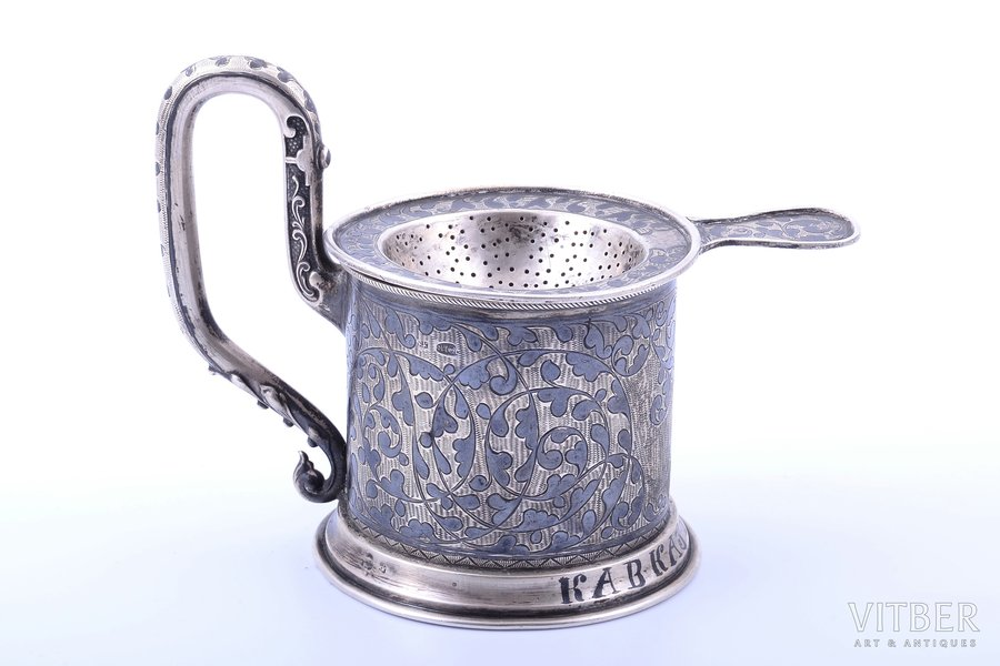 "set, tea glass-holder, strainer, silver, ""Caucasus"", 84 standart, niello enamel, 1896-1907, 155.10 g, glass holder 117.90 g + strainer 37.20g, Russia, glass holder: h (with handle) 10.8 cm, Ø (inside) 6.9 cm, strainer11.5 x 8 cm"