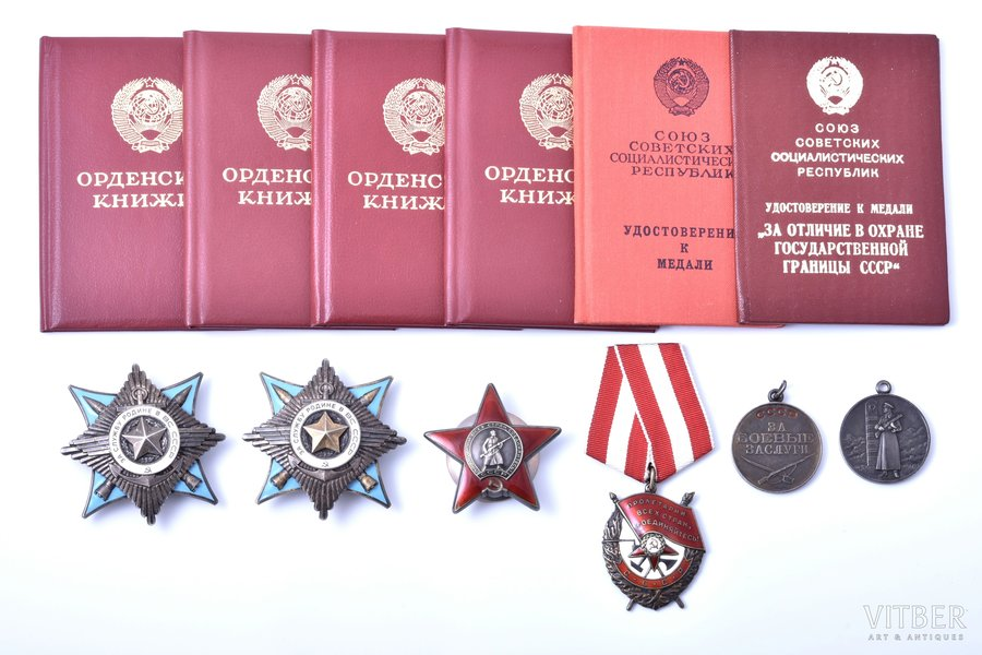 set of awards and documents, awarded to Pavlenko Gennady Nikolaevich: order For Service to the Motherland in USSR armed forces, Nº 1217, 2nd class (1989); order For Service to the Motherland in USSR armed forces, Nº 60010, 3rd class (1988); Order of the Red Star № 3789157 (1987, micro chip on the surface of beam 7 o'clock); Order of the Red Banner Nº 478167 (1984); medal For Military Merit (1981); medal, For Distinction in Guarding the State Border of the USSR (1979), USSR, 1979-1989, awards of one of the outstanding and most effective helicopter pilots of the Afghan war. 10 years of continuous participation in combat operations. Over 1000 combat missions. The winner of the lot will receive a set of copies of record-cards.