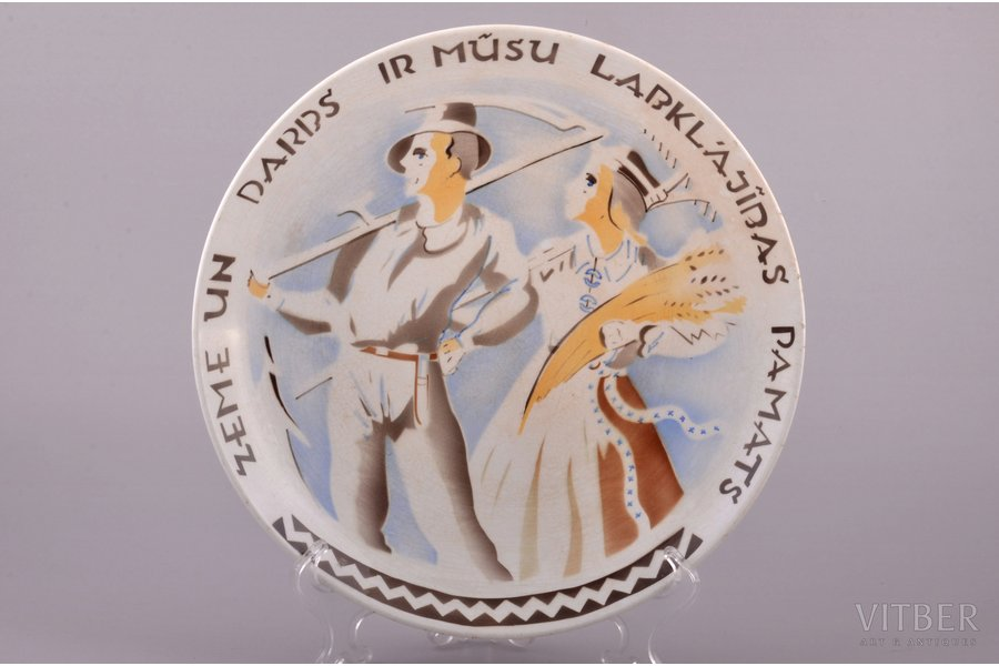 wall plate, Soil and work is the basis of our prosperity, porcelain, J.K. Jessen manufactory, sketch by Niklavs Strunke, Riga (Latvia), the 30ties of 20th cent., Ø 25.2 cm