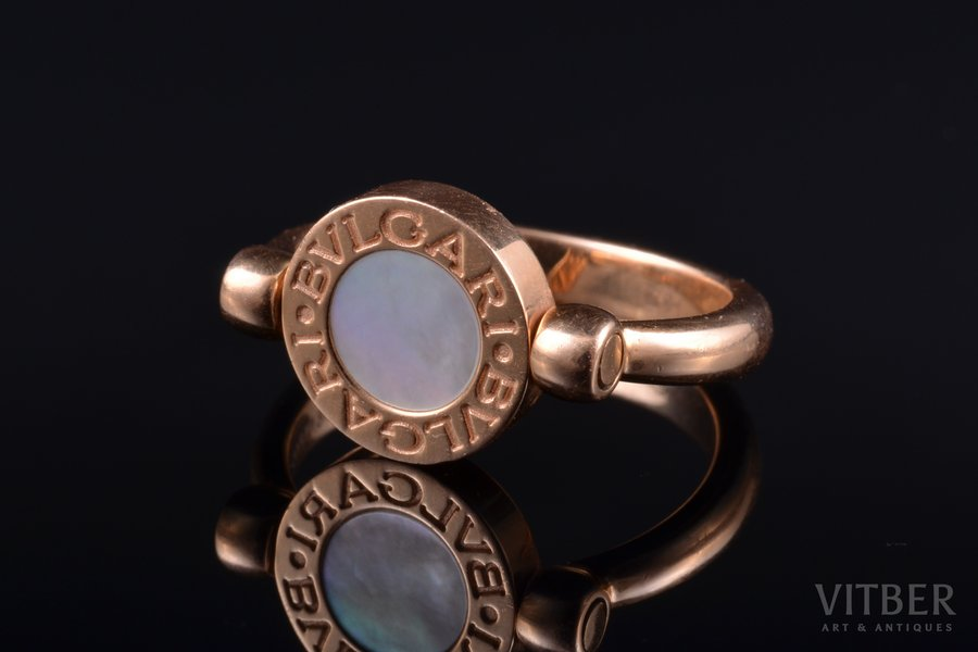 flip ring, gold, 7.17 g., the size of the ring 17.25, onyx, mother-of-pearl, Bulgari, Italy, with original box and case