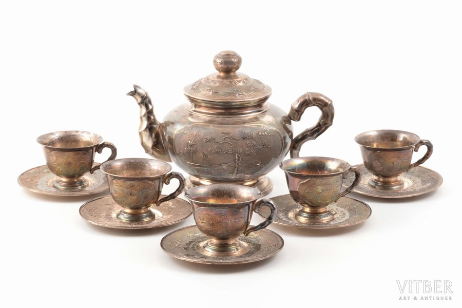 service: teapot and 5 tea pairs, silver, 875 standart, total weight of items 637.40 g, Vietnam, h (teapot) 11.3 cm, h (cup) 3.8 cm, Ø (saucer) 8.5 cm, import mark of the Soviet Union