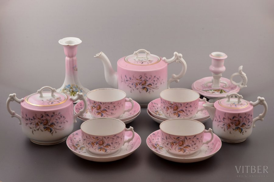 set, 15 items: teapot, sugar bowl, cream jug, 4 cups, 6 saucers, 2 candlesticks, porcelain, M.S. Kuznetsov manufactory, Russia, 1891-1917, Dmitrov factory; spout of the teapot with chip and hairline crack, 2 cups with chips on the edges, one cup with hairline crack, one of cendlesticks restorated, one of candlesticks without hallmark and with chip on the edge