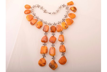 a necklace, amber, largest amber stone size 3.6 x 3.1 cm, smallest amber stone size 2.4 x 1.6 cm, metal, 100 g., the item's dimensions 38.5 cm