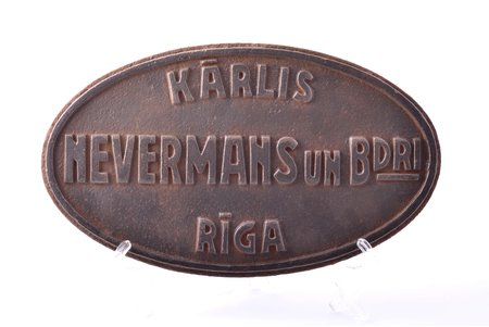 """cast iron plaque, company """"Kārlis Nevermans un biedri"""", Riga, plaque was embedded in asphalt in Mežaparks, Latvia, the 20-30ties of 20th cent., 30.5 x 17.8 x 1.9 cm, weight 4700 g"""