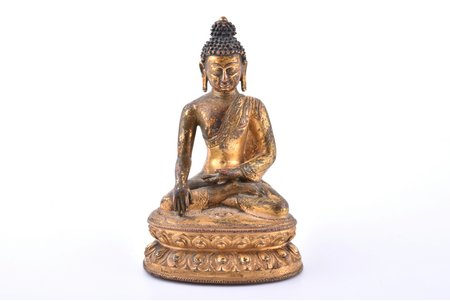 "figurine, Buddha Shakyamuni, translation of the inscription: (upper line) ""I bow to the teacher Buddha Shakyamuni"" (lower line) ""Senkor Namgyal (proper name), parents and children, set / done for them"", bronze, h 13 cm, weight 383.80 g., Tibet, the 15th/16th cent."