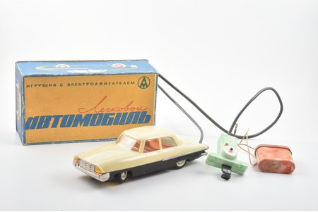 a toy, passenger car, with electric motor, plastic, USSR, in a box