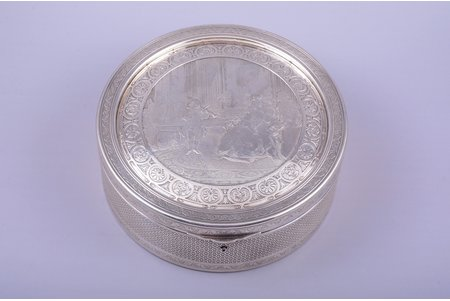"""case, """"Mozart chez madame de Pompadour"""" (young Mozart playing the violin for Madame de Pompadour and her guests), signature """"B. Wicker gr."""", silver plated, Ø 19 cm, h 7 cm"""